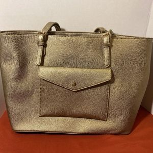Madison West gold purse with straps and pocket on